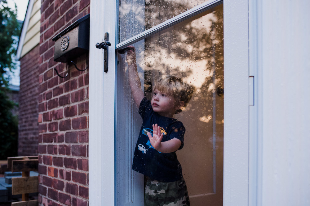 Francesca Russell Photography | Documentary Family Photographer on Long Island | Little boy at door