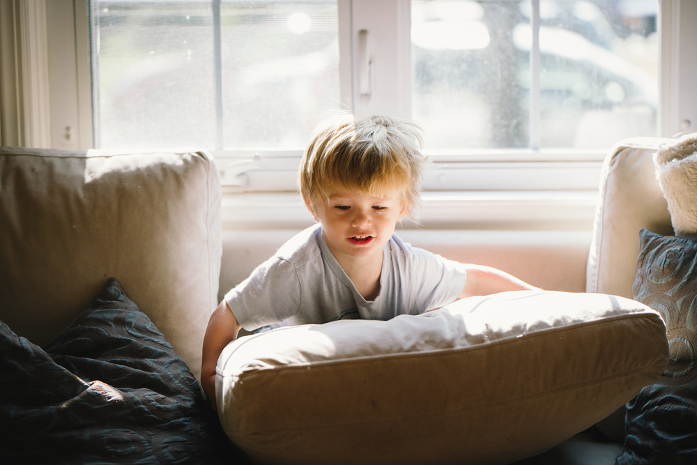 Francesca Russell Photography | Documentary Family Photographer on Long Island | Little boy playing on couch