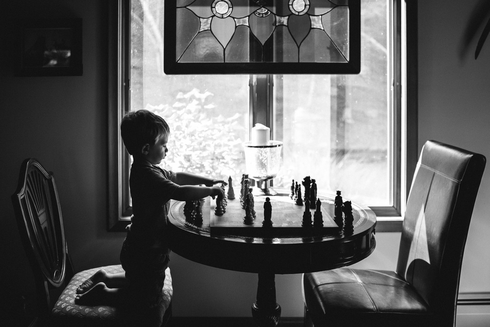 Francesca Russell Photography | Documentary Family Photographer on Long Island | Boy playing chess