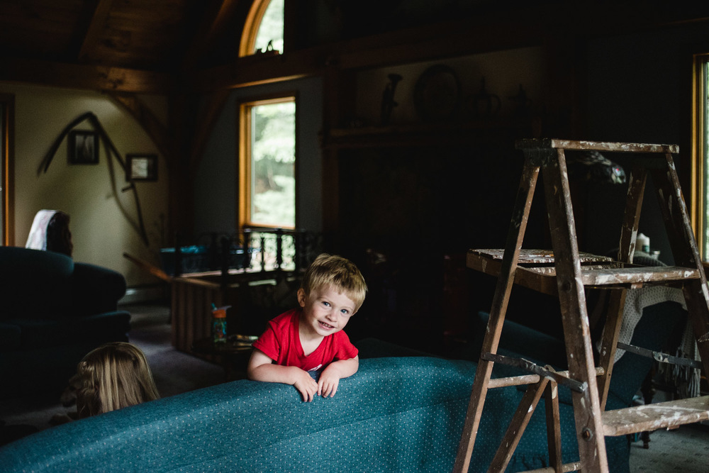 Francesca Russell Photography | Documentary Family Photographer on Long Island | Boy on couch
