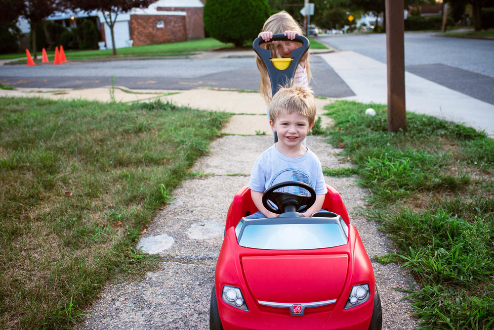 Francesca Russell Photography | Long Island Family Documentary Photography | Pushing Logan around the block
