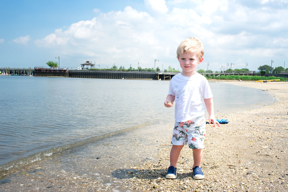 Francesca Russell Photography | Long Island Family Documentary Photography | Logan throwing rocks