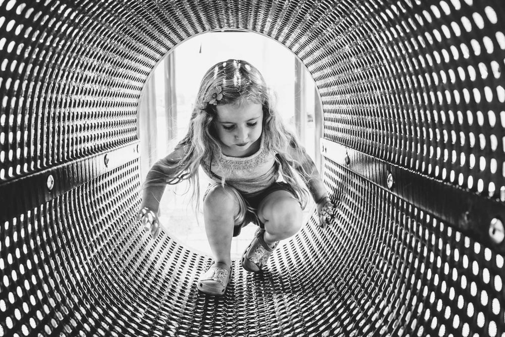 Francesca Russell Photography | Long Island Family Photographer | Lila in the tunnel at the playground