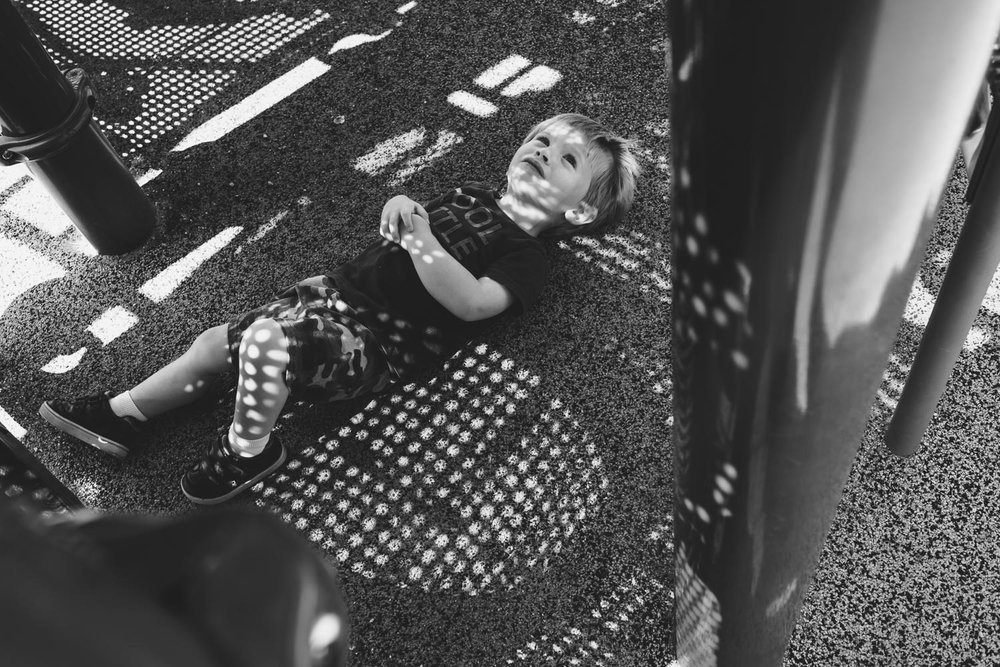 Francesca Russell Photography | Long Island Family Photographer | Logan taking a rest at the playground