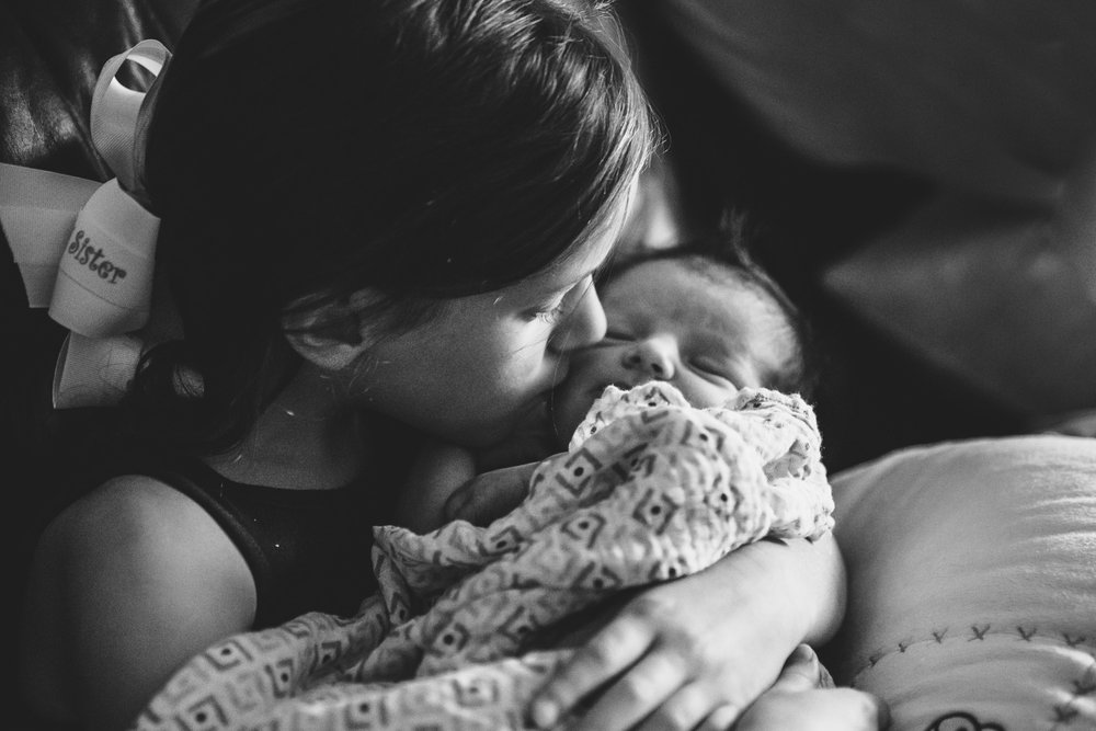Francesca Russell Photography | Long Island Newborn Photographer | Big sister kissing baby