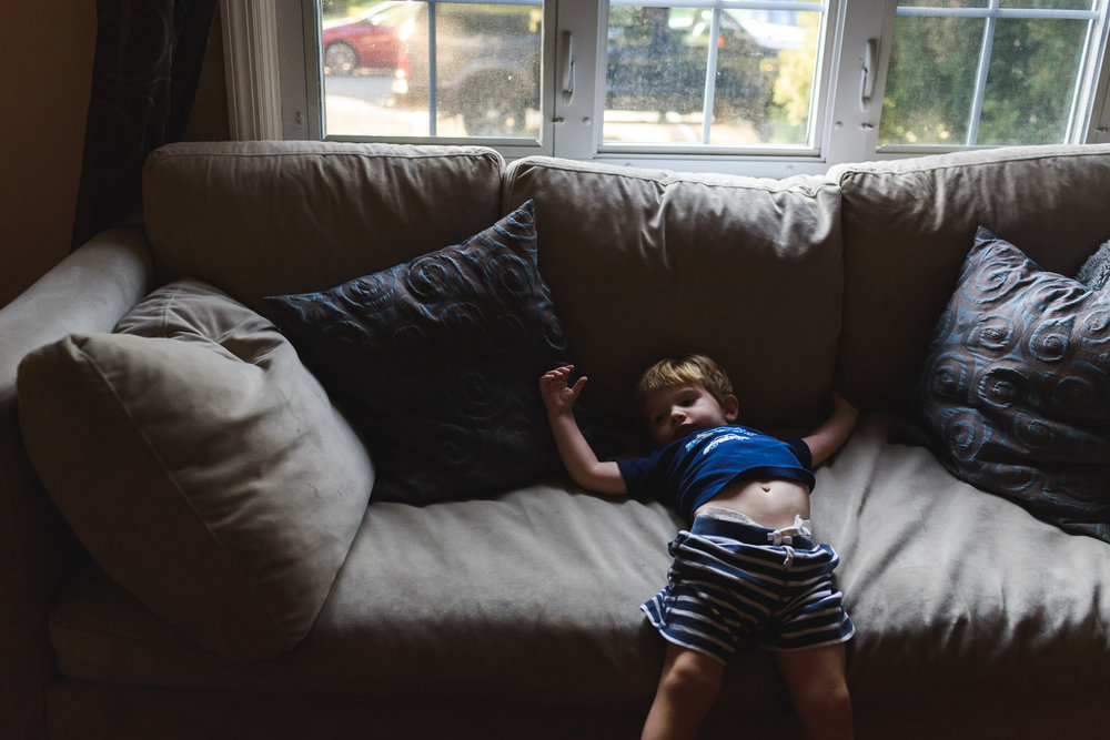 Francesca Russell Photography | Long Island & New York City Family Photographer | Boy stretching on couch
