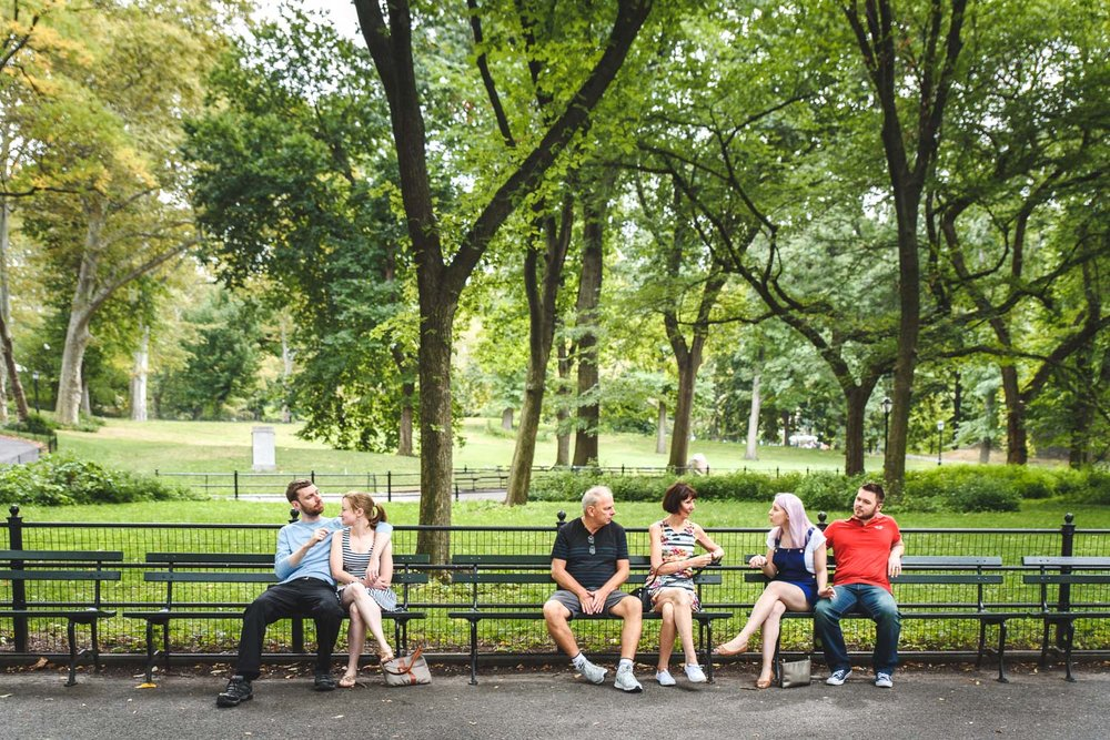 Francesca Russell Photography | New York City Vacation Photographer | Family sitting on a bench in Central Park
