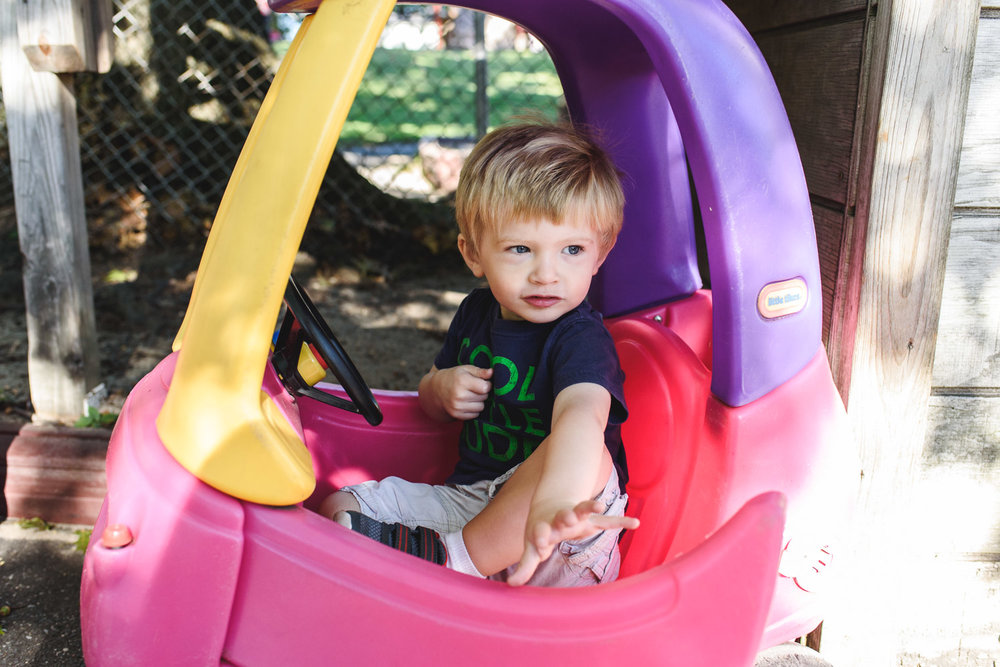 Francesca Russell Photography | Long Island Documentary Family Photographer | Logan in toy car