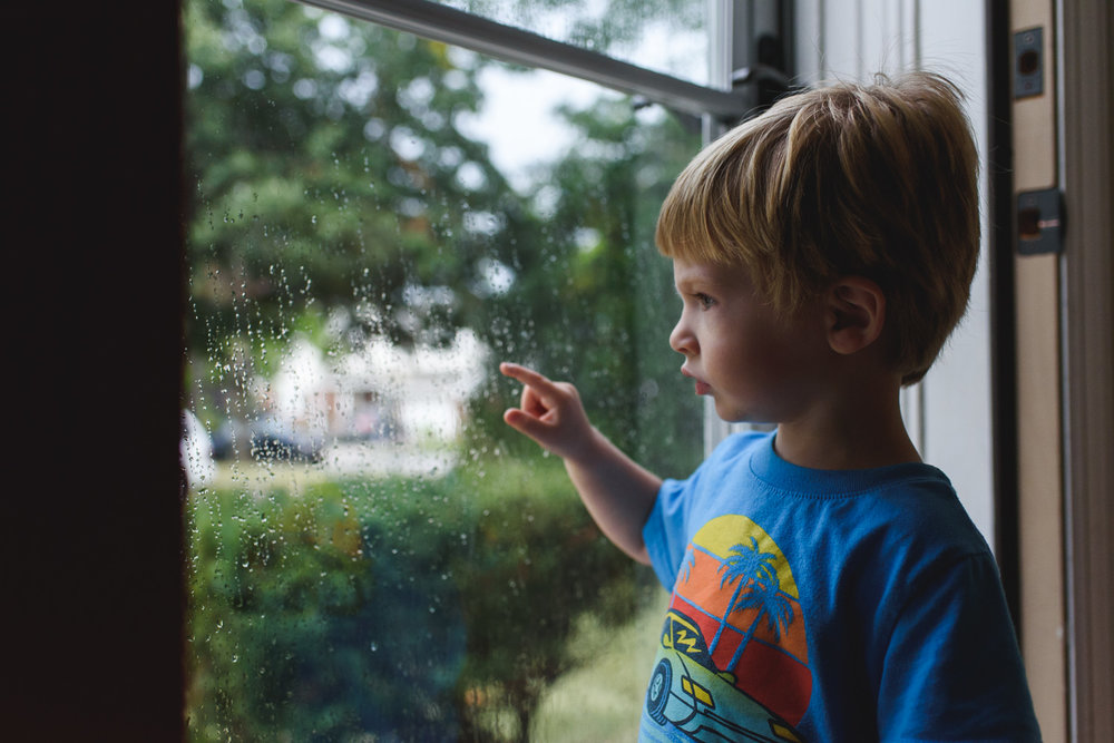 Francesca Russell Photography | Long Island Documentary Family Photographer | Logan watching the rain fall