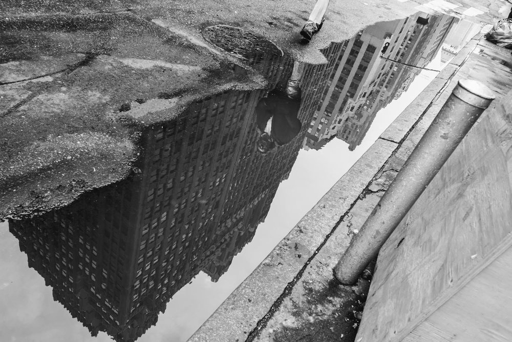 Reflection in puddle in New York City.
