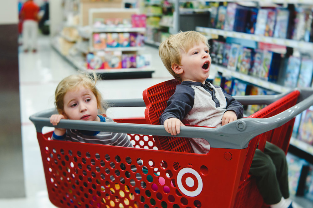 Children in shopping cart at Target.