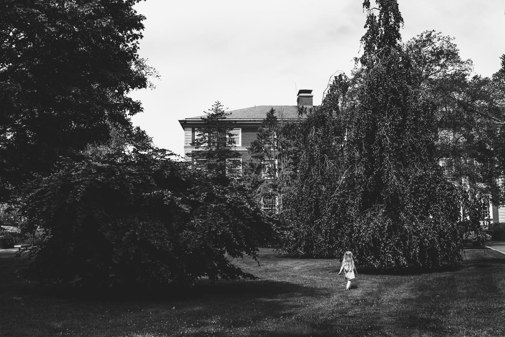 Little girl exploring the grounds at Adelphi University.