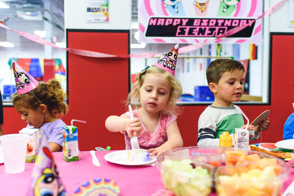 Children enjoying cake at a birthday party at Gold Medal Gymnastics in Garden City.