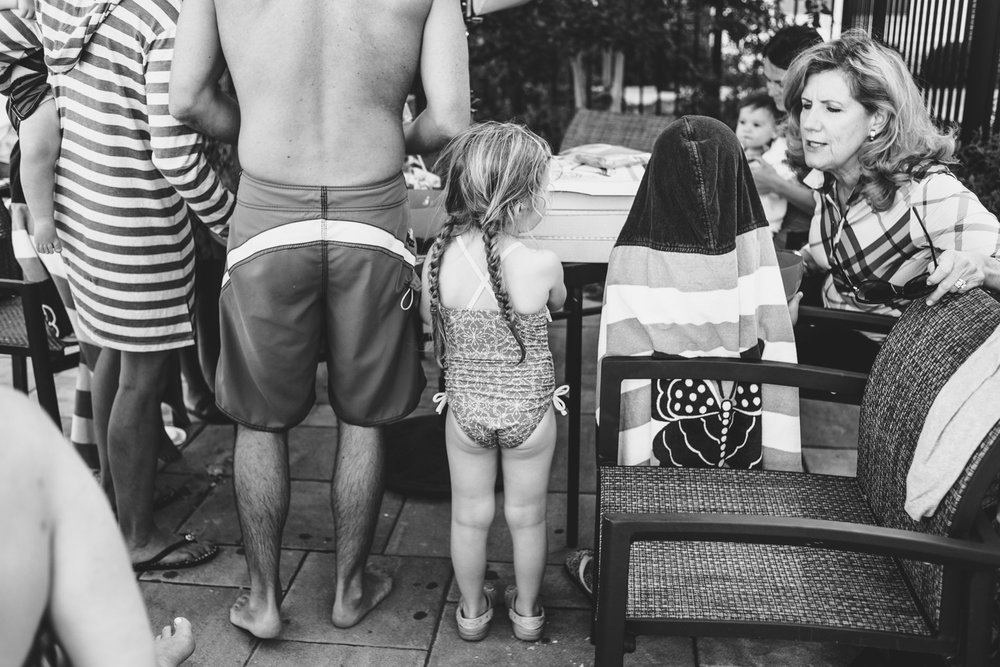 Waiting for cake at a birthday pool party.