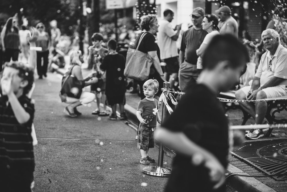 Little boy amidst the crowds at the 7th Street Promenade in Garden City.
