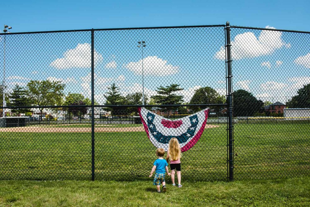 Kids by flag at baseball fields in Garden City, NY.