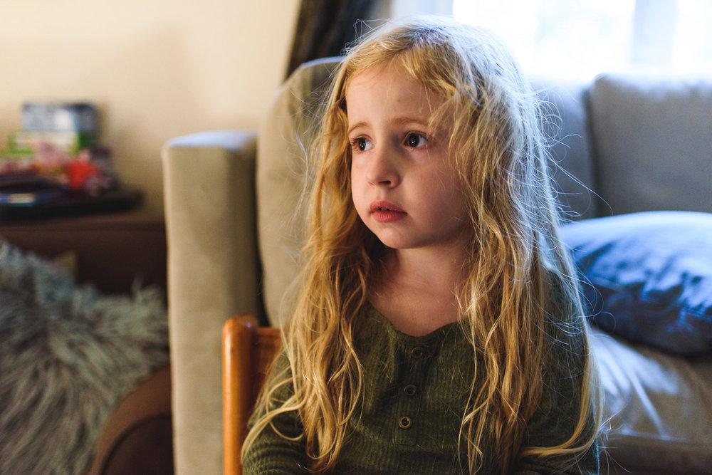 Portrait of little girl in living room