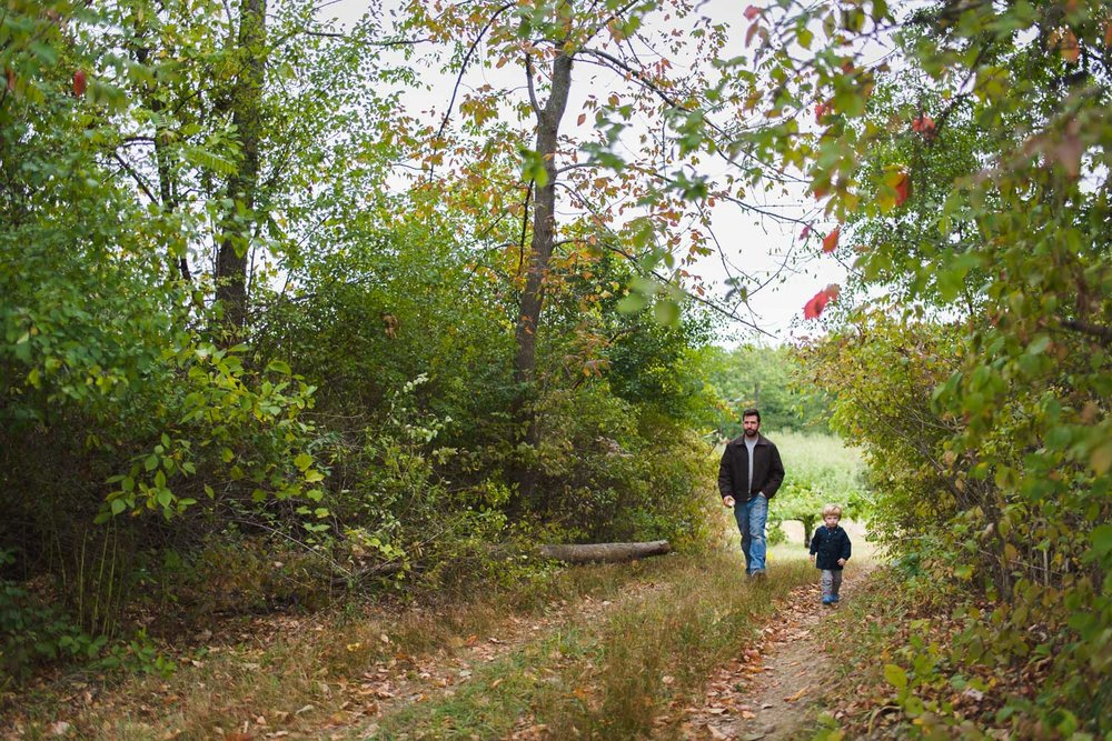 Father and son exploring the orchards at Philip Orchards in New York.