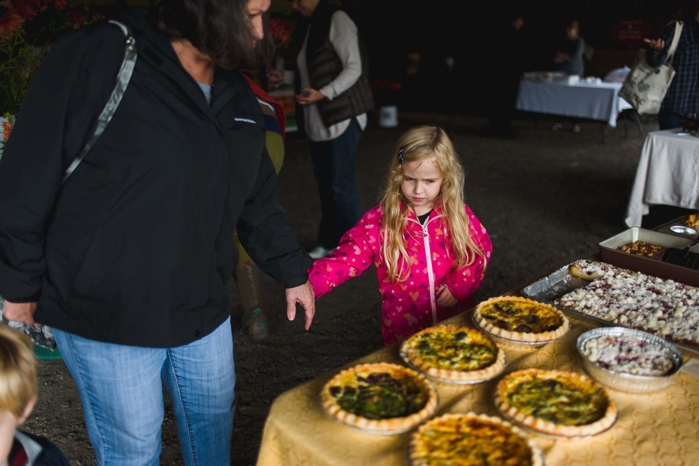 Looking at the quiches at the Hillsdale Copake Farmer's Market.