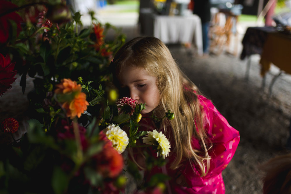 Smelling flowers at the Farmer's Market