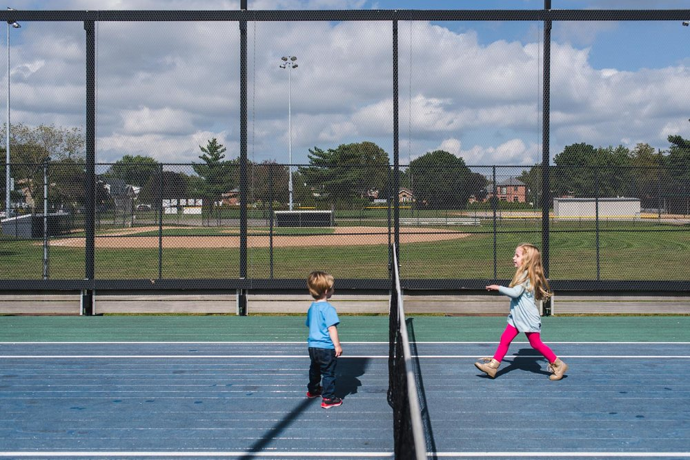 Kids playing at tennis courts.