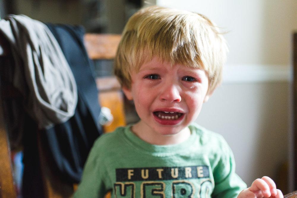 Toddler boy crying.