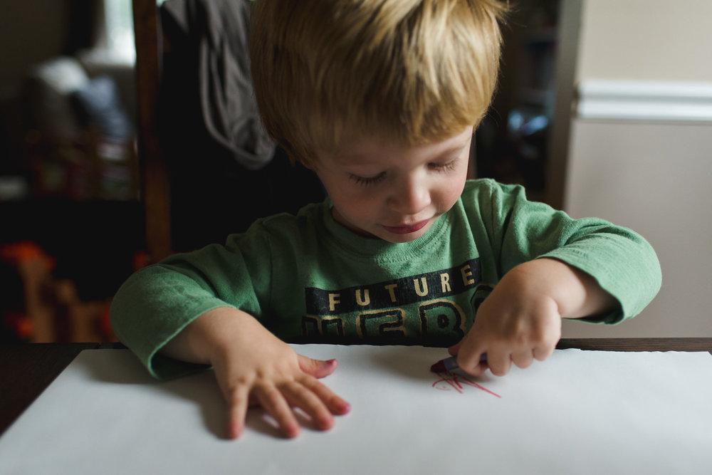 Toddler boy drawing.