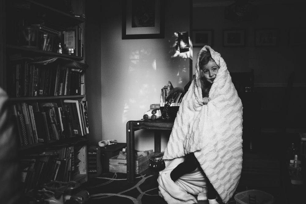 Little girl wrapped in blanket.