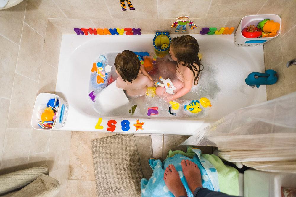 Children taking a bath.