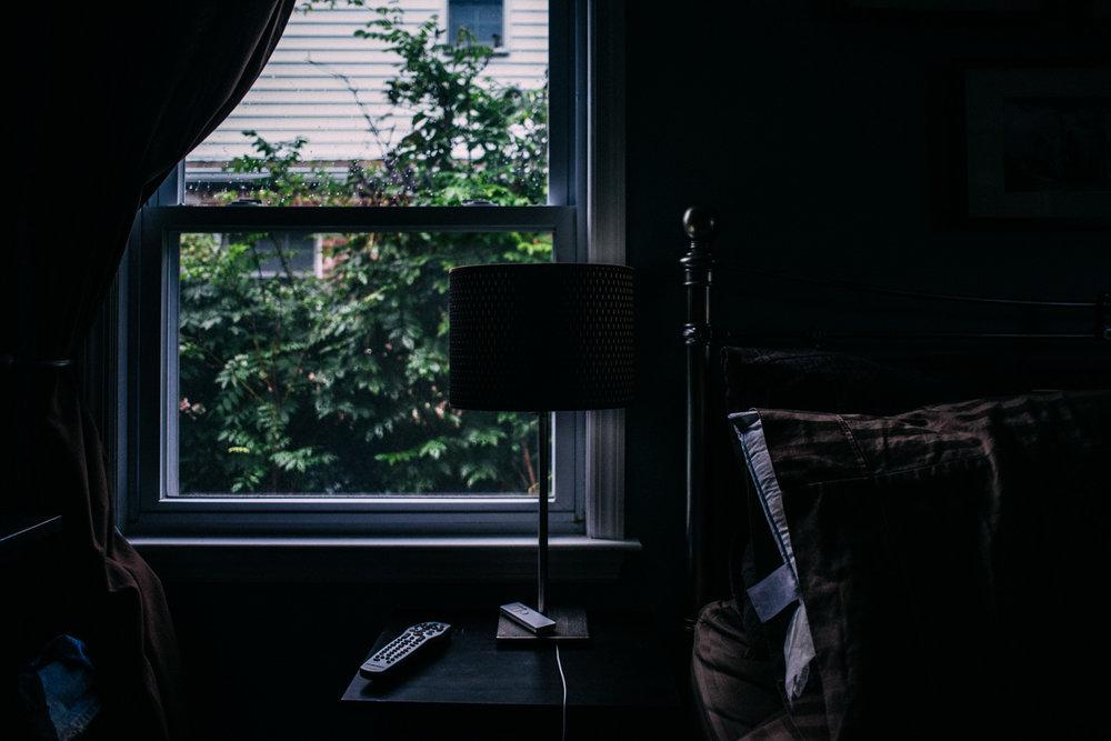 Rainy weather outside bedroom window.