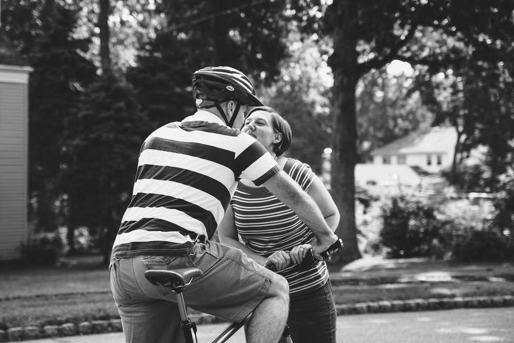 Couple reaching for a kiss.