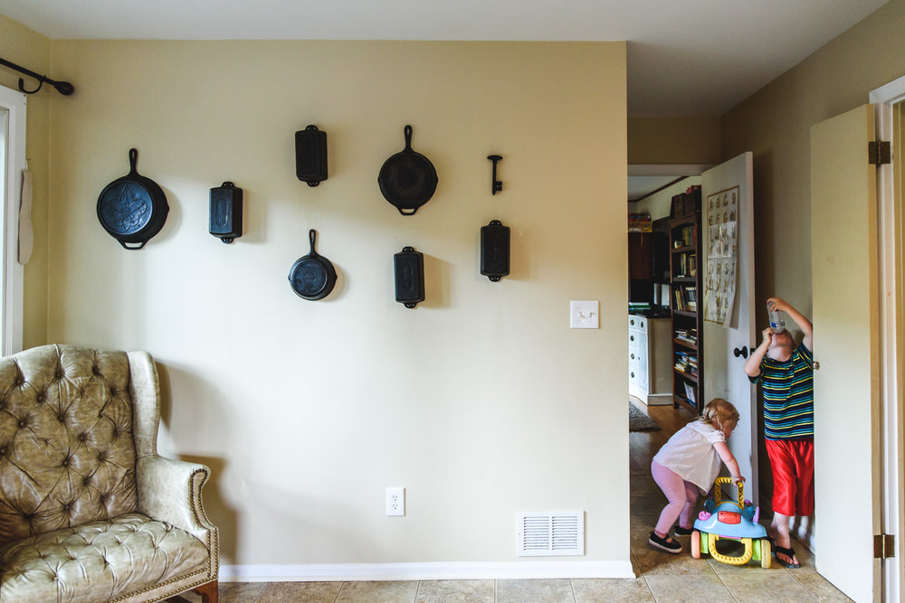 Kids playing in kitchen hallway.