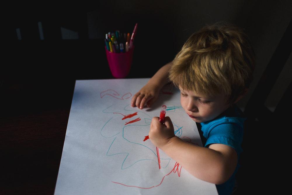 Little boy drawing.