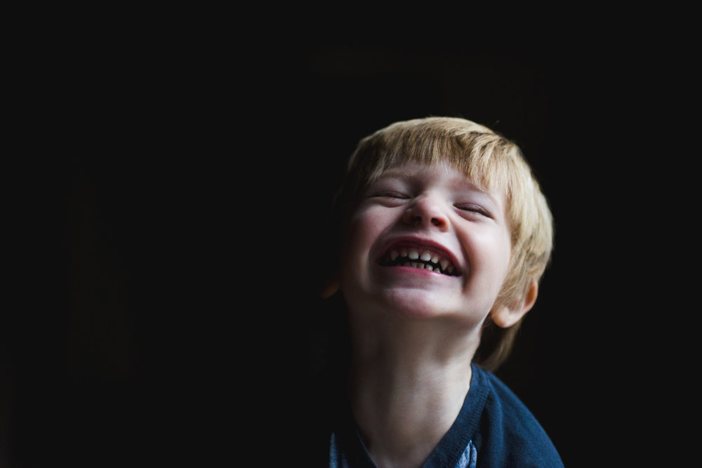 Toddler boy smiling.