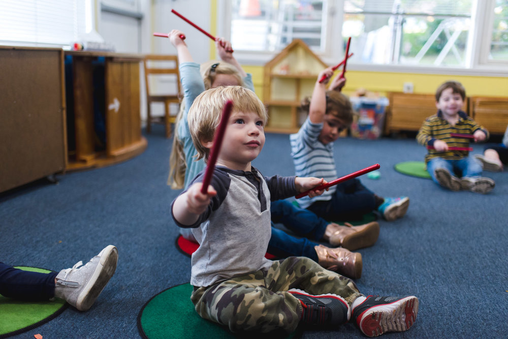 Little boy enjoying music class.