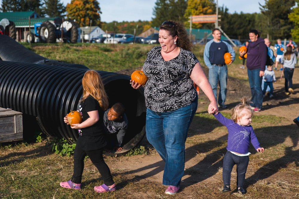 Mother and kids at pumpkin farm.