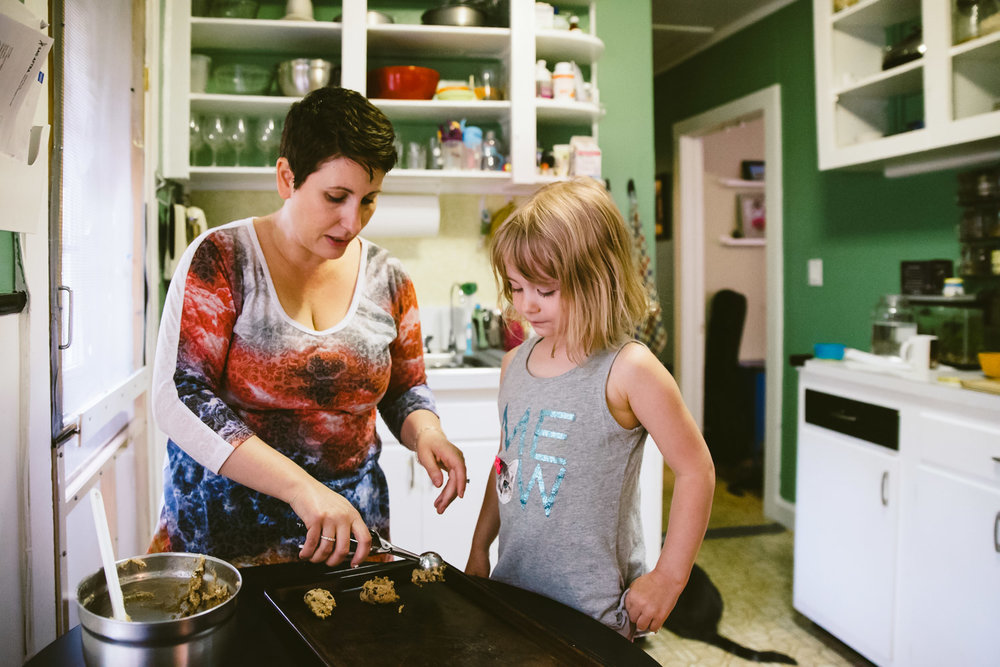 Mother and Daughter baking cookies.