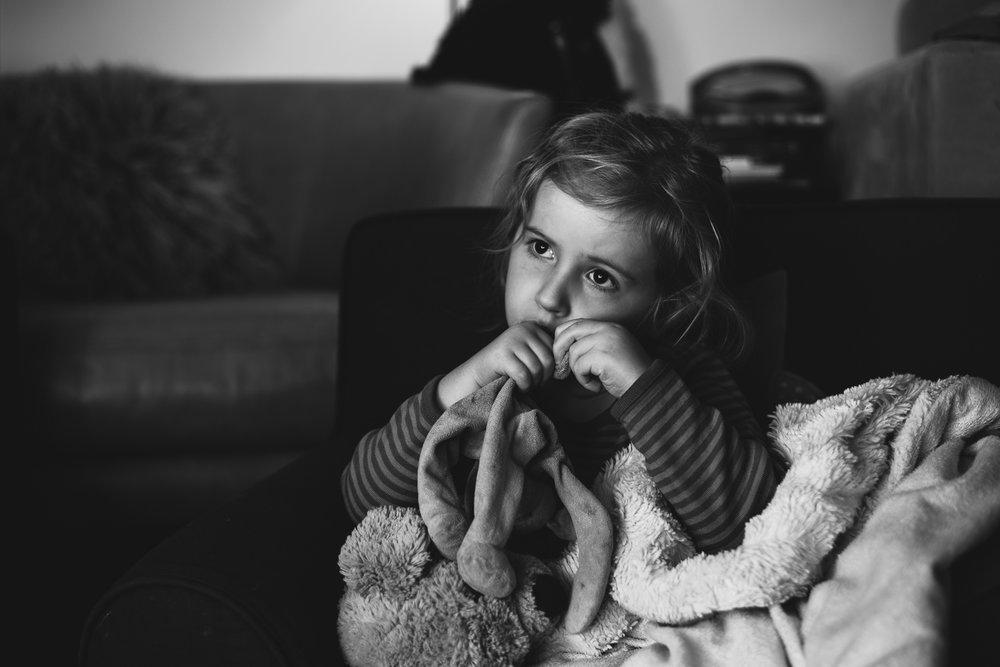 Little girl watching television.