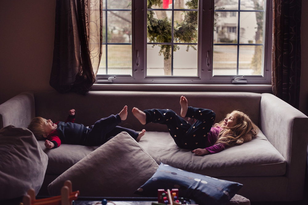 Kids playing on the couch.
