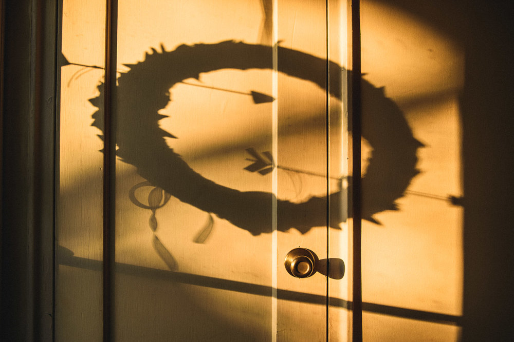 Shadow of a wreath on a door.