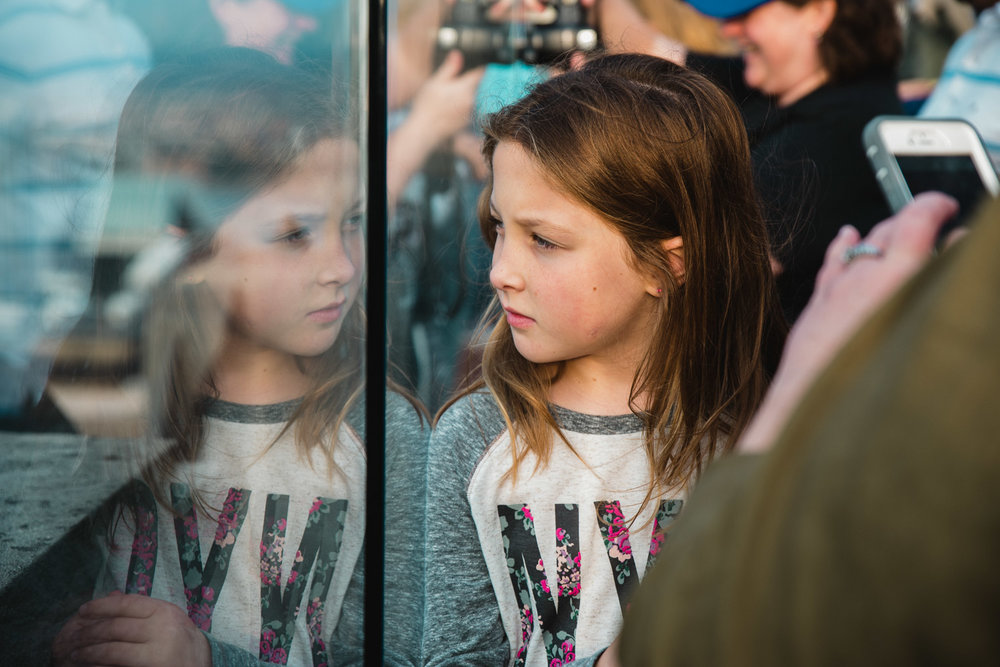 A girl looking out from the observation deck at Top of the Rock.
