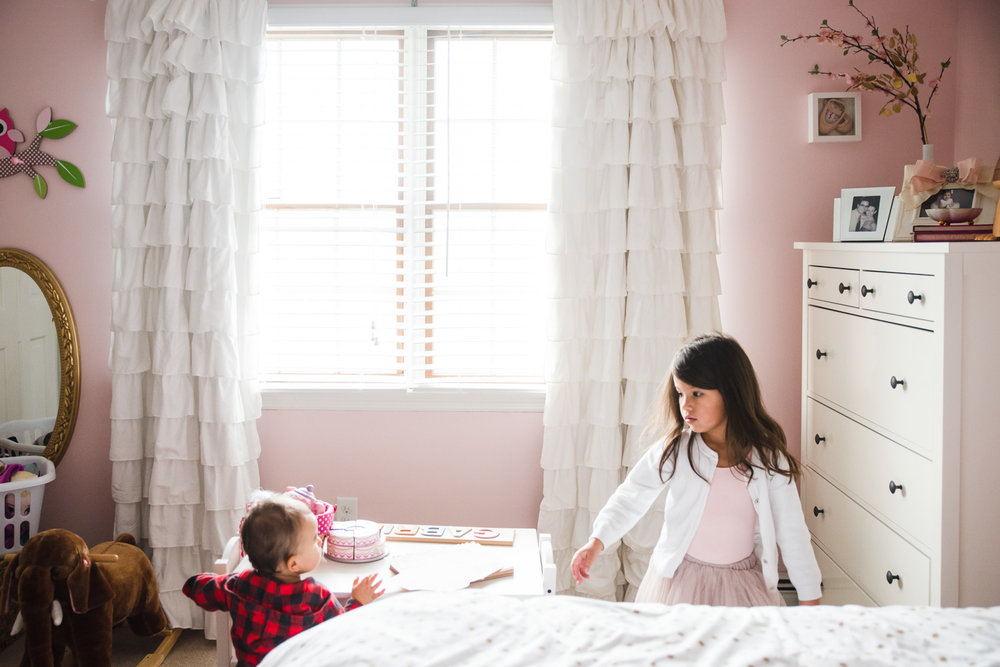 Sister and  brother in pink bedroom.