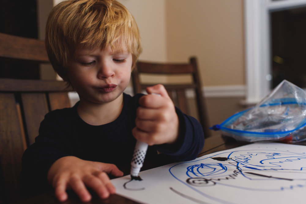 Little boy drawing a picture.