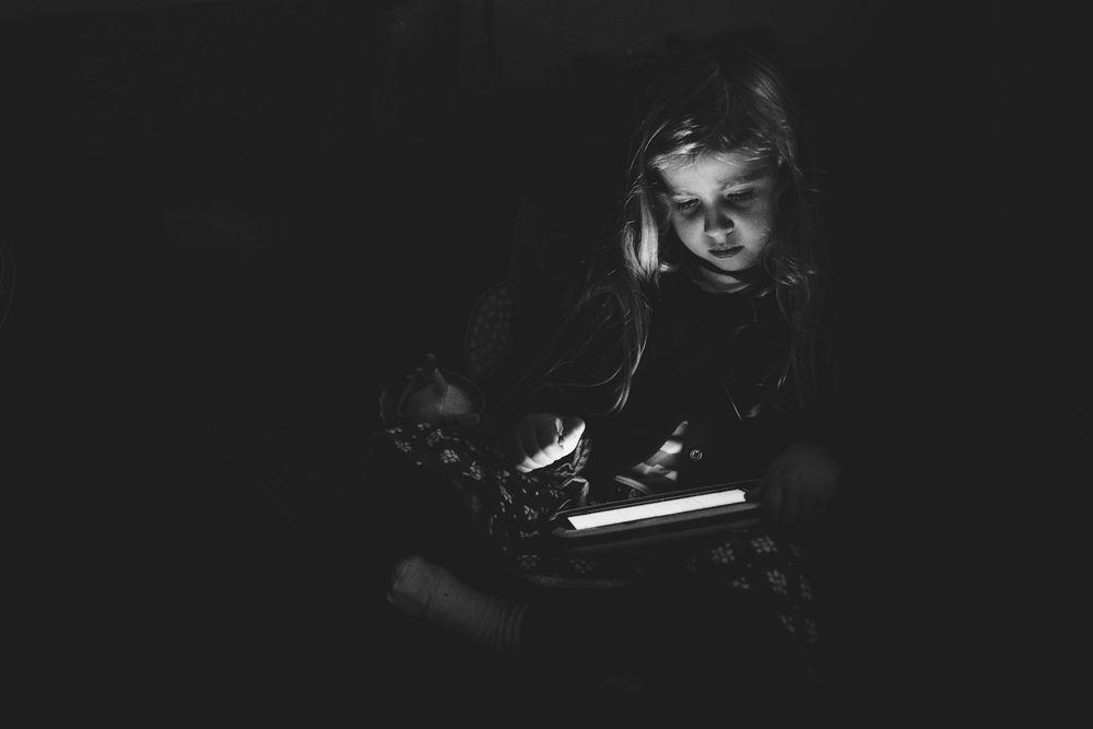 Little girl watching an iPad.