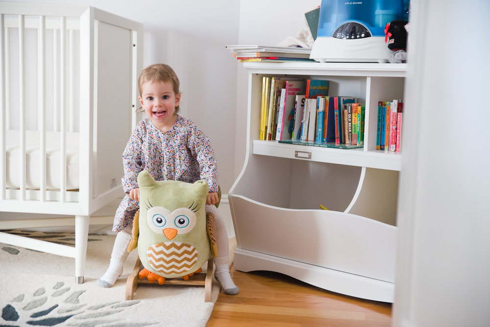 Toddler on a stuffed owl.