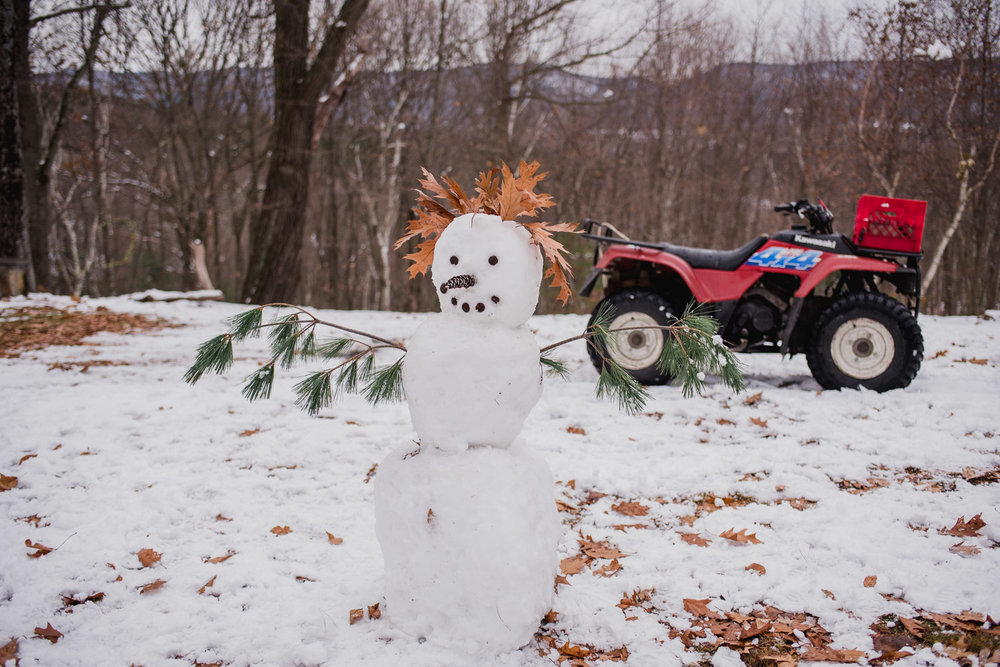 A finished snowman stands in the backyard at Copake.
