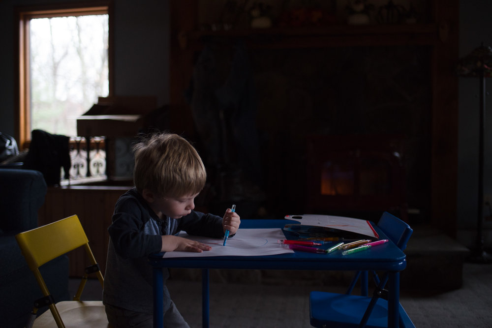 Little boy coloring.