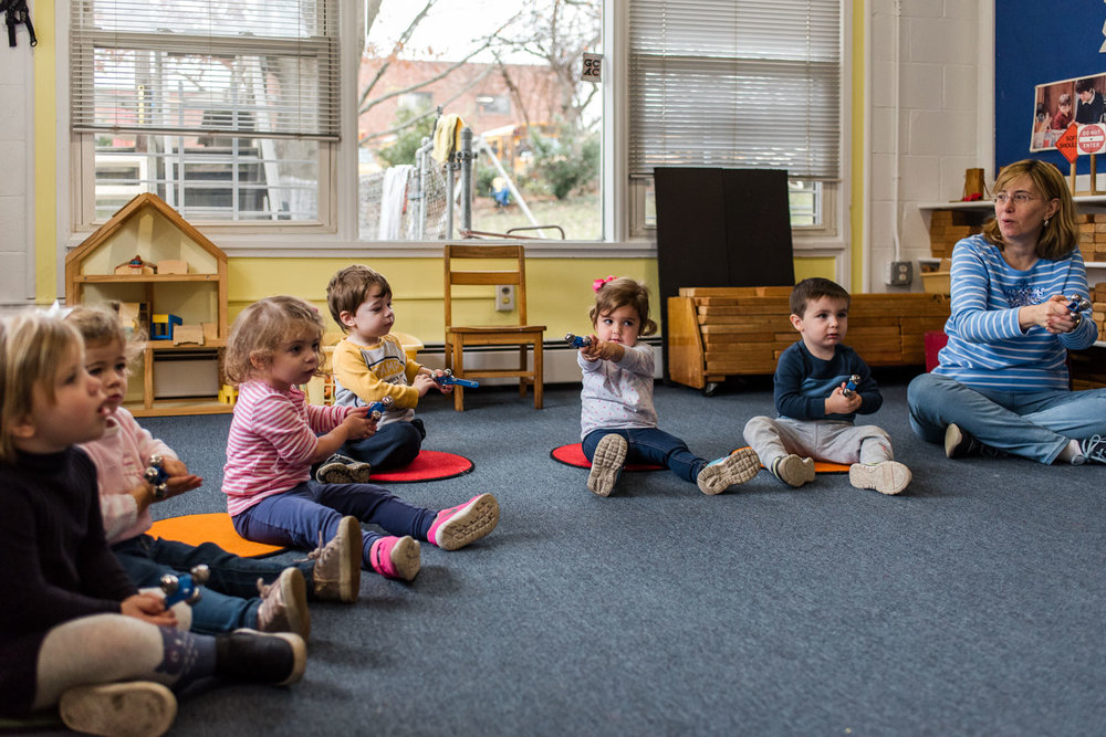 Nursery school kids sing songs during circle time.