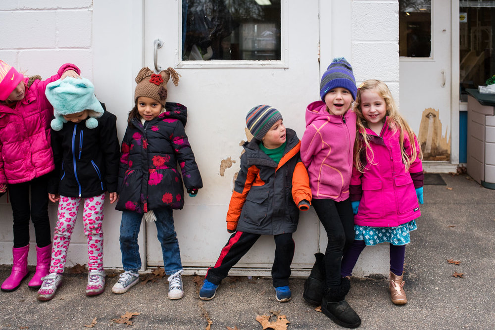Pre-K children lining up after recess.