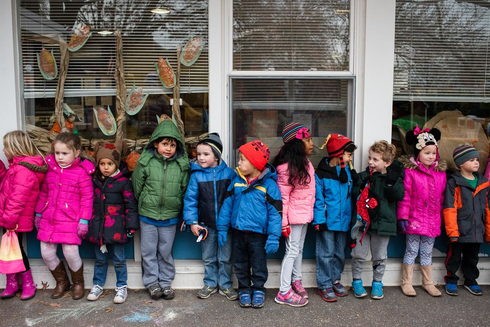 Kids in line after recess at nursery school.